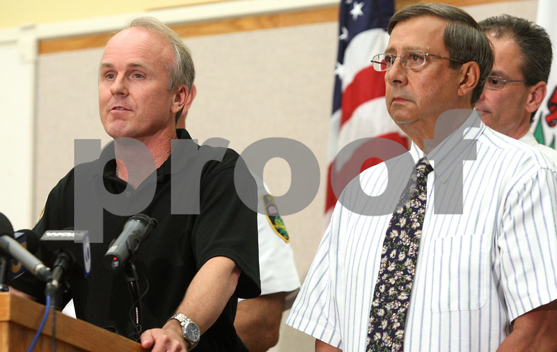 Kyle Bursaw – kbursaw@daily-chronicle.com<br /> <br /> DeKalb County State's Attorney Clay Campbell introduces Maria Ridulph's older brother Charles Ridulph (right) to the media during a press conference at the DeKalb County Legislative Center in Sycamore, Ill. on Wednesday, July 27, 2011.