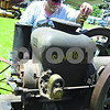Bob Ronning, of Somonauk, looks over his 6-horsepower Sandwich engine, made in 1913 by Sandwich Manufacturing. Ronning found the engine in an old orchard and had to take it out in pieces, recreate the wooden parts, then piece it back together. It was once used to cut firewood.