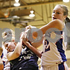 Rob Winner – rwinner@daily-chronicle.com<br /> <br /> River Ridge-Scales Mound's Kaitlyn Pleau (left) and Hinckley-Big Rock's Katie Hollis struggle for a ball under the Lady Royals' basket during the third quarter of the IHSA Class 1A DeKalb Super-Sectional on Monday February 21, 2011 in DeKalb, Ill.<br /> <br /> ***Tess Godhardt of H-BR is in the back to the left**