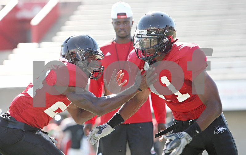 Rob Winner – rwinner@daily-chronicle.com<br /> <br /> Dominique Ware (left) and Rashaan Melvin work on a drill during practice on Tuesday, Aug. 16, 2011, in DeKalb, Ill.