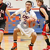 Rob Winner – rwinner@daily-chronicle.com<br /> <br /> Genoa-Kingston's Bryan Baumgarten drives past two Stillman Valley defenders to the basket during the first quarter in Genoa, Ill. on Tuesday, Jan. 11, 2011. The Cogs went on to defeat the Cardinals, 49-44.