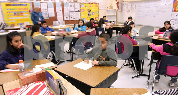 Kyle Bursaw – kbursaw@daily-chronicle.com<br /> <br /> Students in Dr. Hilda Rivera's fourth grade class, including Kevin Villazana (center), observe a moment of silence during the morning announcements at Littlejohn Elementary in DeKalb, Ill. on Wednesday, Jan. 19, 2011.