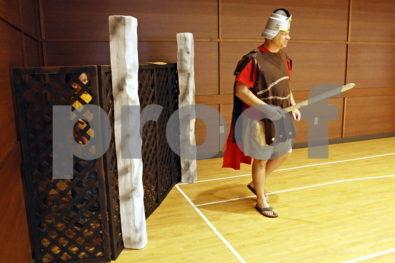 """Rob Winner – rwinner@shawmedia.com<br /> <br /> Evan Thompson, 8 of Sycamore, is jailed by Pastor Bob Weinhold, playing a roman soldier, during a """"Night in Bethlehem Market Place"""" at St. John Lutheran Church in Sycamore on Saturday, Dec. 10, 2011."""