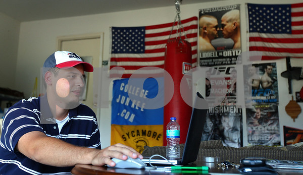 Kyle Bursaw – kbursaw@shawmedia.com<br /> <br /> Entrepreneur Alex Broches moderates his dating website collegejunkee.com from his garage in Sycamore, Ill. on Wednesday, Aug. 31, 2011.