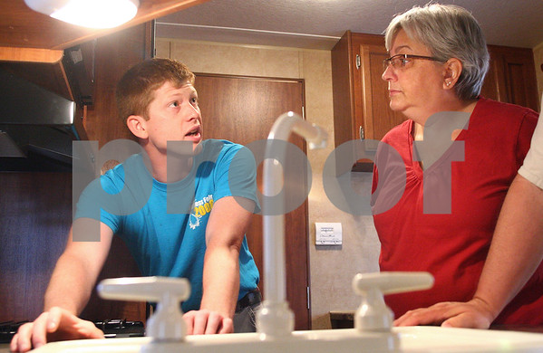 Kyle Bursaw – kbursaw@daily-chronicle.com<br /> <br /> Joe Clark (left), of Holiday Hour RV, explains all the features and functions of the camper purchased by Deb Ward and her husband James (not pictured) in Cortland, Ill. on Friday, June 17, 2011.