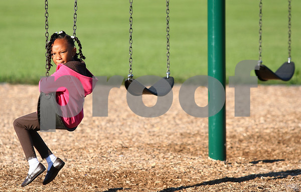 Kyle Bursaw – kbursaw@shawmedia.com<br /> <br /> Founders Elementary first grader Madison McNeil sits on the swings. Students had some time on the playground entering the school on the first day of school on Tuesday, Sept. 6, 2011.