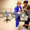 Kyle Bursaw – kbursaw@shawmedia.com<br /> <br /> Occupational Therapist LaToya McNutt (right) wraps up Oak Crest resident Ina Koehler's hand after dipping it in paraffin wax during a treatment session <br />  in Oak Crest's renovated rehabilitation area on Wednesday, Nov. 9, 2011.