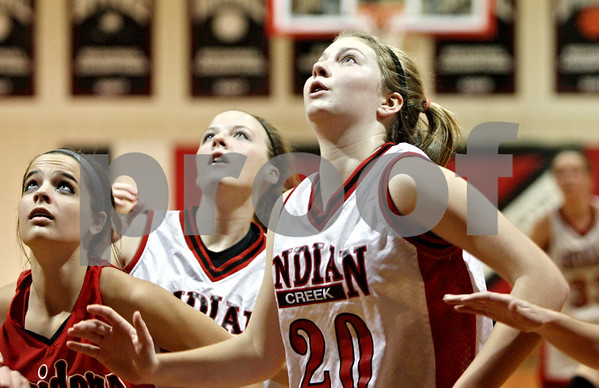 Rob Winner – rwinner@daily-chronicle.com<br /> <br /> Indian Creek's Kate Thuestad prepares for a potential rebound underneath the Timberwolves' basket during the first quarter of a game on Thursday, January 6, 2011, against Leland-Earville.
