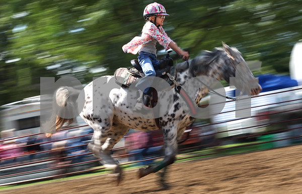 Kyle Bursaw – kbursaw@shawmedia.com<br /> <br /> Samantha Merrigan, 8, rides Cayenne while competing in the Western Horse Show at the Sandwich Fair in Sandwich, Ill. on Wednesday, Sept. 7, 2011.