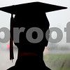 Kyle Bursaw – kbursaw@daily-chronicle.com<br /> <br /> A Somonauk Community High School senior looks at the heavy rain outside before the commencement ceremony at the school on Sunday, May 29, 2011.