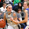 Kyle Bursaw – kbursaw@shawmedia.com<br /> <br /> Hiawatha's Dani Clark maneuvers around Hinckley-Big Rock's Lauren Paver during the second quarter of their game in Kirkland, Ill. on Monday, Dec. 12, 2011.