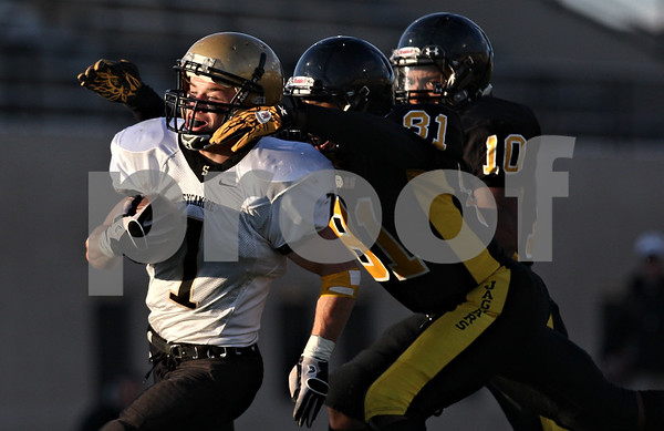 Rob Winner – rwinner@shawmedia.com<br /> <br /> Sycamore running back Austin Culton (1) is chased down by King's Cedric Malone (81) during the second quarter of a Class 5A playoff game in Chicago on Saturday, October 29, 2011. Sycamore defeated King, 36-29.