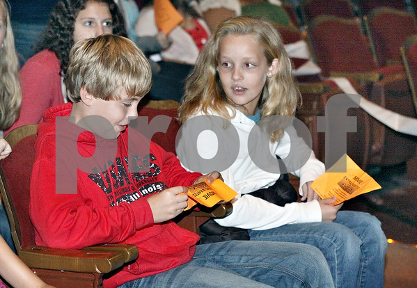Wendy Kemp – For The Daily Chronicle<br /> <br /> Chris Canada, 14 (left) and Kylie Feuerbach, 10, of Sycamore, wait their turn during the casting call at the Egyptian Theatre on Sunday.<br /> <br /> DeKalb, Ill.<br /> September 18, 2011