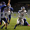 Rob Winner – rwinner@shawmedia.com<br /> <br /> Burlington Central's Joe Breeden returns a punt for the Rockets' first touchdown during the first quarter in Genoa, Ill. on Friday, Sept. 30, 2011.
