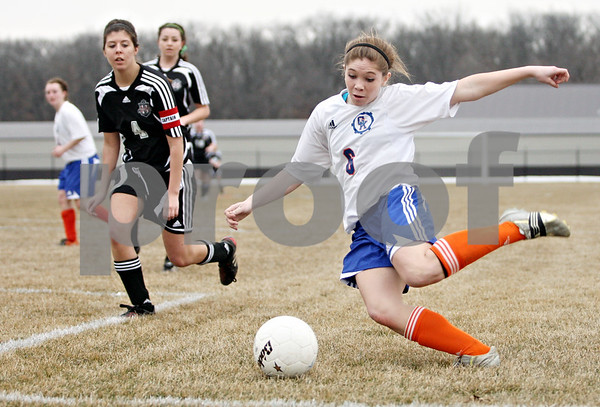 Rob Winner – rwinner@daily-chronicle.com<br /> <br /> Genoa-Kingston's Shannon Schumacher takes a shot during the second half. Genoa-Kingston went on to defeat Indian Creek, 5-1.