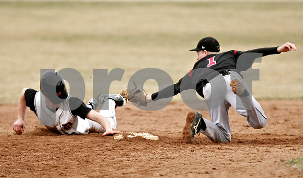 Rob Winner – rwinner@daily-chronicle.com<br /> <br /> DeKalb's Jake Gordon (left) tries to steal second in the bottom of the fourth inning but is tagged out by Auburn shortstop Peter Norberg on Monday, March 21, 2011, in DeKalb, Ill.