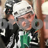 Kyle Bursaw – kbursaw@daily-chronicle.com<br /> <br /> Chi-Town Shamrocks captain Sean Conlon chats with others while waiting to rotate back in during the open skate at the Kishwaukee YMCA on Thursday, Jan. 6, 2011.