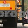 Kyle Bursaw – kbursaw@shawmedia.com<br /> <br /> A student steps off of a bus at Founders Elementary on the morning of Thursday, Sept. 29, 2011. A few busloads of students transfer at Founders to go to other elementary schools in the district.