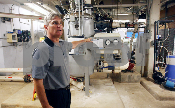 Rob Winner – rwinner@daily-chronicle.com<br /> <br /> Superintendent Jim Briscoe explains that the mechanicals beneath the pool at Huntley Middle School have been replaced and rebuilt and should last for many years to come during a tour on Monday afternoon in DeKalb.