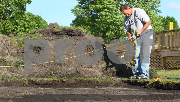 Kyle Bursaw – kbursaw@daily-chronicle.com<br /> <br /> Liners General Manager Josh Pethoud works on an area where a pavilion will go in at Sycamore Park on Tuesday, May 31, 2011.