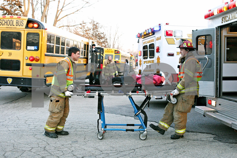 Rob Winner – rwinner@daily-chronicle.com<br /> <br /> A second student is taken off a Sycamore school bus on a stretcher and put on to an ambulance by emergency personnel after an accident in front of Evergreen Village in Sycamore on Tuesday afternoon.