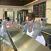 Carole Fawaz, owner of the Sunshine Scoop Shoppe & Bakery on W. Lincoln Highway, scoops ice cream for a customer Friday afternoon. The shop has been open for three weeks and serves 32 flavors of Hershey's ice cream, along with specialty cakes, pies and other ice cream desserts.<br /> <br /> By Nicole Weskerna - nweskerna@daily-chronicle.com