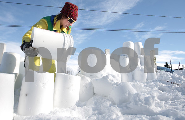 Kyle Bursaw – kbursaw@daily-chronicle.com<br /> <br /> Courtney Sliga, 26, digs out cars in her parking lot with a bucket, while creating the lining for a path with the compacted snow from the bucket. Sliga didn't have a shovel and decided to use a bucket instead.