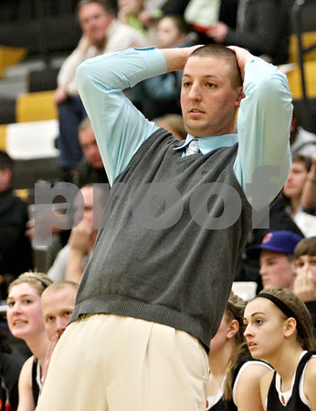 Rob Winner – rwinner@daily-chronicle.com<br /> <br /> DeKalb coach Ben Bates reacts as his team nearly turns the ball over during the fourth quarter on Thursday, Feb. 10, 2011 in Sycamore, Ill. Sycamore went on to defeat DeKalb, 34-30.