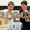 Rob Winner – rwinner@shawmedia.com<br /> <br /> Kaneland's Drew David (11) moves the ball while being pressured by DeKalb guard Brian Sisler (10) during the first quarter in Maple Park, Ill., on Friday, Dec. 16, 2011. Kaneland defeated DeKalb, 58-46.