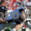 Rob Winner – rwinner@shawmedia.com<br /> <br /> Northern Illinois linebacker Pat Schiller (53) tackles Western Michigan quarterback Alex Carder (14) during the second quarter in DeKalb, Ill., on Saturday, Oct. 15, 2011. Northern Illinois defeated Western Michigan, 51-22.