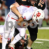 Kyle Bursaw – kbursaw@shawmedia.com<br /> <br /> DeKalb's Michael Halverson (70) sacks Ottawa quarterback William Hoffman (7)during the second quarter of the game in DeKalb, Ill. on Friday, Aug. 26, 2011.