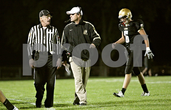 Rob Winner – rwinner@shawmedia.com<br /> <br /> Sycamore coach Joe Ryan talks with a referee after Ryan was flagged on the sidelines during the second quarter in Sycamore, Ill., on Friday, Sept. 23, 2011.