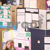 Kyle Bursaw – kbursaw@daily-chronicle.com<br /> <br /> Kacie Nelson, 12, reads a book at her display on prairie invasion while waiting for the judges at the 2011 Illinois Junior Academy of Science – Northern Region V Science Fair Regional Project Session Semi-Finals in the Holmes Student Center at NIU on Saturday, March 12, 2011.
