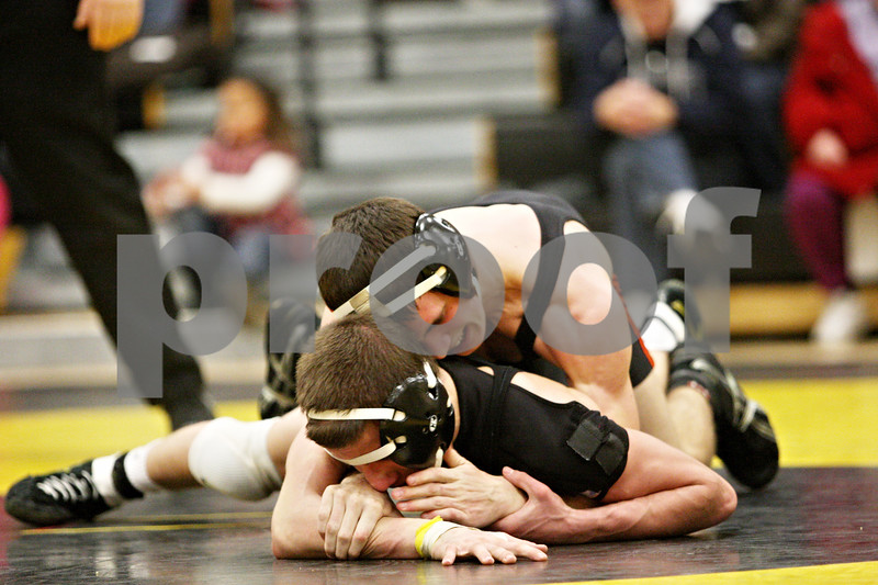 Rob Winner – rwinner@daily-chronicle.com<br /> <br /> DeKalb's Jake Jones holds down Sycamore's Chris Kerwin in their 119-pound match on Thursday, Jan. 13, 2011 in Sycamore, Ill. However, Kerwin would go on to win the match for Sycamore.