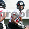 Rob Winner – rwinner@daily-chronicle.com<br /> <br /> Anthony Johnson (right) and teammate A.J. Sebastiano run a drill during practice at Huskie Stadium in DeKalb, Ill. on Thursday, Aug. 4, 2011.