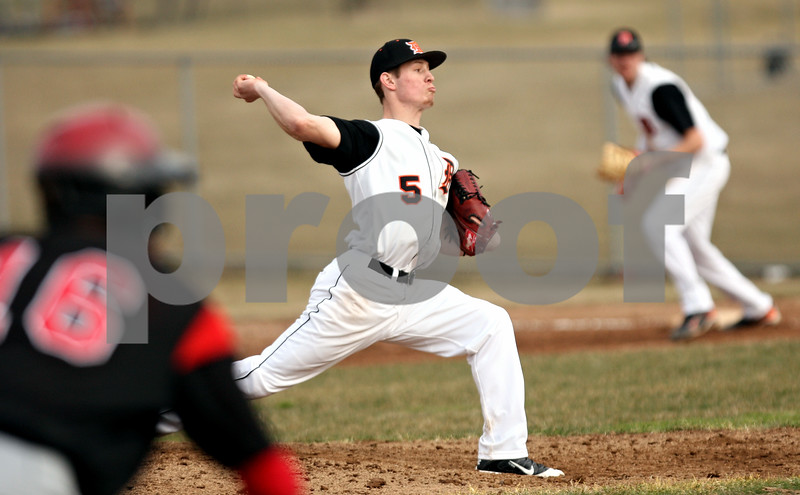 Rob Winner – rwinner@daily-chronicle.com<br /> <br /> DeKalb's Jake Gordon delivers a pitch during the top of the third inning on Monday, March 21, 2011, in DeKalb, Ill.