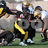 Rob Winner – rwinner@shawmedia.com<br /> <br /> King running back DeVonte Rimmer (center) is wrapped up by Sycamore's Alex Feczko (7) during the second quarter of a Class 5A playoff game in Chicago on Saturday, October 29, 2011. Sycamore defeated King, 36-29.