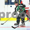 Kyle Bursaw – kbursaw@daily-chronicle.com<br /> <br /> Josiah Wells shoots for the goal as fellow Chi-Town Shamrocks teammate Evan Stravers (far right) chases after him at the Kishwaukee YMCA during the open skate on Thursday, Jan. 6, 2011.