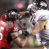 Kyle Bursaw - kbursaw@daily-chronicle.com<br /> <br /> Northern Illinois defensive end Sean Progar (95) battles with Toledo offensive lineman Mike VanDerMeulen (74) in DeKalb, Ill. on Nov. 9, 2010.