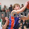 Kyle Bursaw – kbursaw@daily-chronicle.com<br /> <br /> Genoa-Kingston's Robert Thurlby shoots  during the first quarter of the game against Rock Falls. The Genoa-Kingston Cogs defeated the Rock Falls Rockets 62-49 in Genoa, Ill. on Tuesday, March 1, 2011.