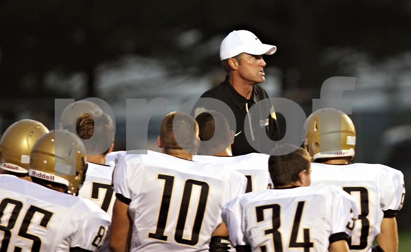 Rob Winner – rwinner@shawmedia.com<br /> <br /> Sycamore coach Joe Ryan talks to his players in the south end zone before a game at Burlington Central on Friday, Sept. 2, 2011.