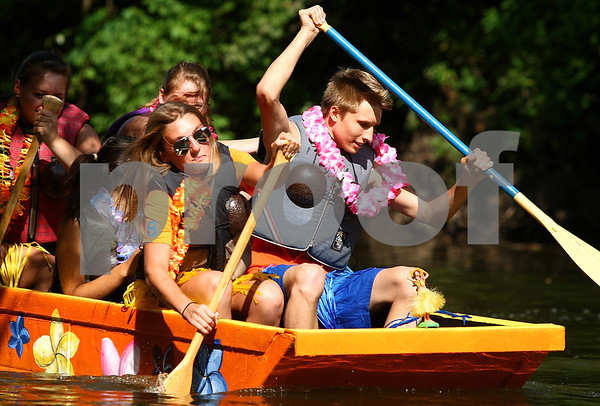 Kyle Bursaw – kbursaw@daily-chronicle.com<br /> <br /> Ariel Rylko (front left) and Peter Hull (front right) paddle their 'Hawaii 6-0' boat <br /> during the Kardboard Boat Regatta at Kingston Fest on Saturday, July 16, 2011.