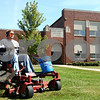 Kyle Bursaw – kbursaw@shawmedia.com<br /> <br /> Josh Davis mows the lawn in front of Malta Elementary on Tuesday, Sept. 20, 2011. Though the school is now closed, District 428 employees still do weekly maintenance at the building.