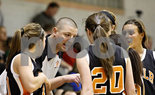 Rob Winner – rwinner@daily-chronicle.com<br /> <br /> After being called for a technical foul, DeKalb coach Ben Bates gathers his players during the fourth quarter.