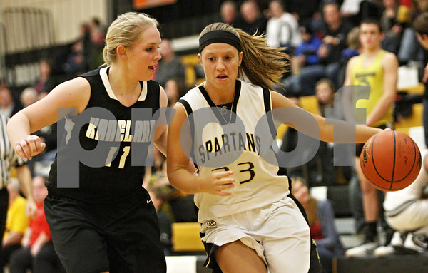 Rob Winner – rwinner@shawmedia.com<br /> <br /> Kaneland's Ashley Prost (11) pressures Sycamore's Ashley Leclair (23) during the third quarter in Sycamore on Friday, Dec. 9, 2011.