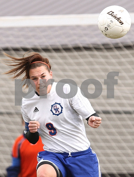 Kyle Bursaw – kbursaw@daily-chronicle.com<br /> <br /> Genoa-Kingston's Alana Dean heads the ball in the first half of the game at Genoa-Kingston high school on Tuesday, April 5, 2011.
