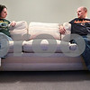 Kyle Bursaw – kbursaw@daily-chronicle.com<br /> <br /> Though happily married, Jeanna and Matthew Grunow will be divided on Sunday when they root for opposing teams during the NFC Championship between the Bears and Packers.<br /> <br /> Thursday, Jan. 20, 2011.