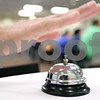 Rob Winner – rwinner@daily-chronicle.com<br /> <br /> At the University Plaza at Northern Illinois University in DeKalb, Matt Duffy of the DeKalb Chamber of Commerce rings a bell alerting attendees of Tuesday night's speed networking session to change seats.