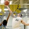Rob Winner – rwinner@daily-chronicle.com<br /> <br /> Sycamore's Jordan Kalk (10) tries to control a rebound over Illinois Math and Science Academy's Chris Norris during the first quarter of an IHSA Class 3A Sycamore Regional game in Sycamore, Ill. on Monday, Feb. 28, 2011.