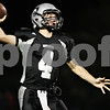 Rob Winner – rwinner@shawmedia.com<br /> <br /> Kaneland quarterback Drew David looks to pass during the first quarter in Maple Park on Friday, Oct. 28, 2011.
